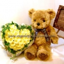 Teddy bear with yellow roses